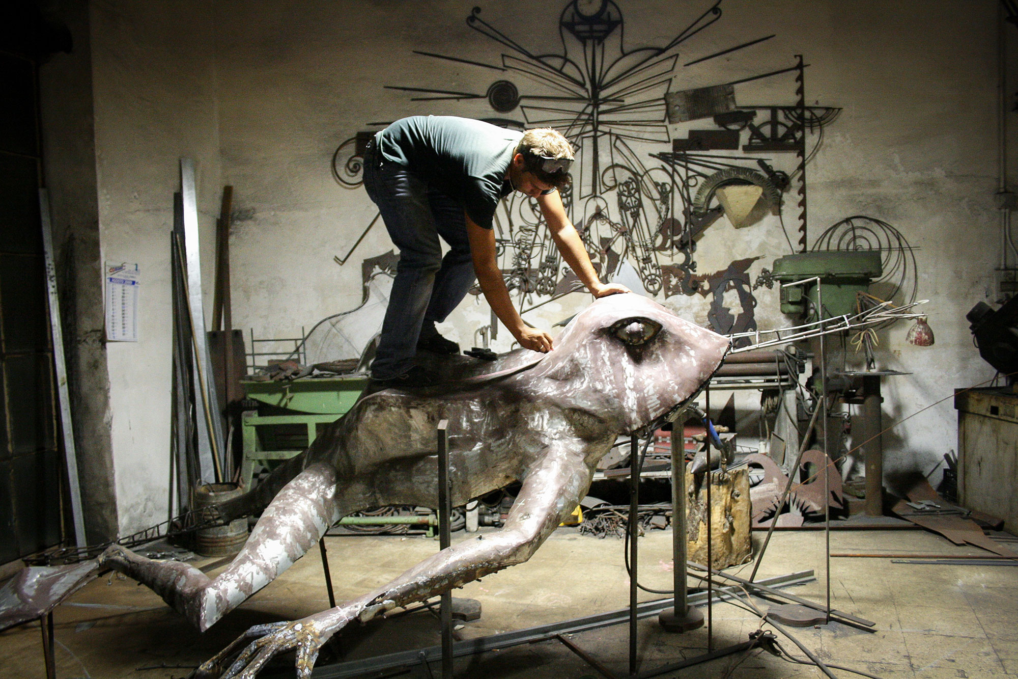 Artist Isaia Zilli working on a Frog statue